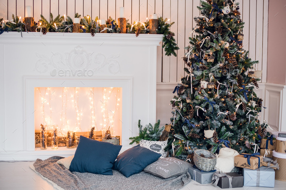Christmas background with illuminated fir tree and fireplace at house - Stock Photo - Images