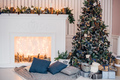 Christmas background with illuminated fir tree and fireplace at house - PhotoDune Item for Sale