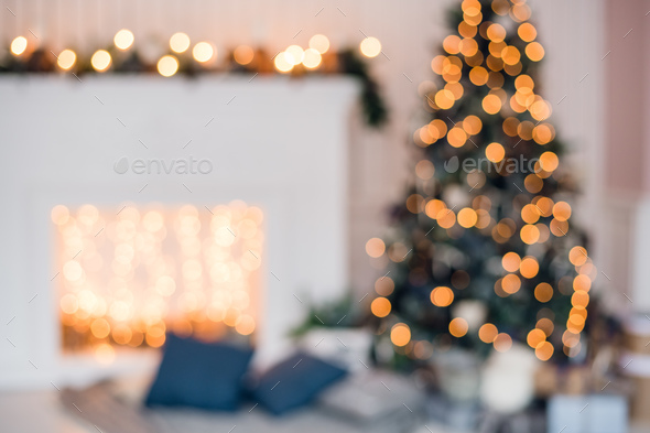 Blurred christmas background with fireplace and christmas tree - Stock Photo - Images