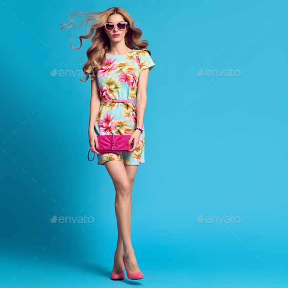 Fashion Young woman.Floral Dress, Heels, Hairstyle - Stock Photo - Images