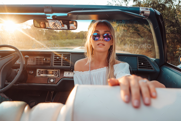 Girl posing in a convertible - Stock Photo - Images