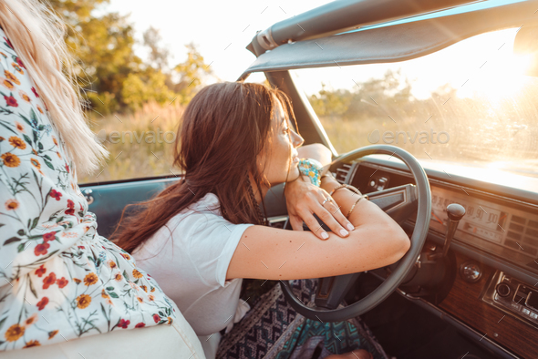 The girl behind the wheel of a car - Stock Photo - Images