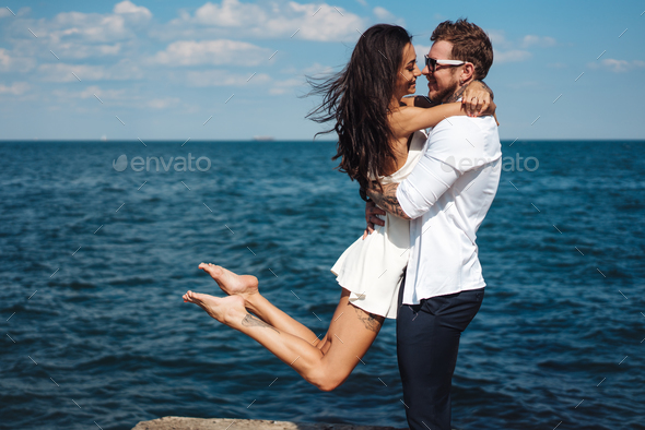 Guy and girl on the sea pier - Stock Photo - Images