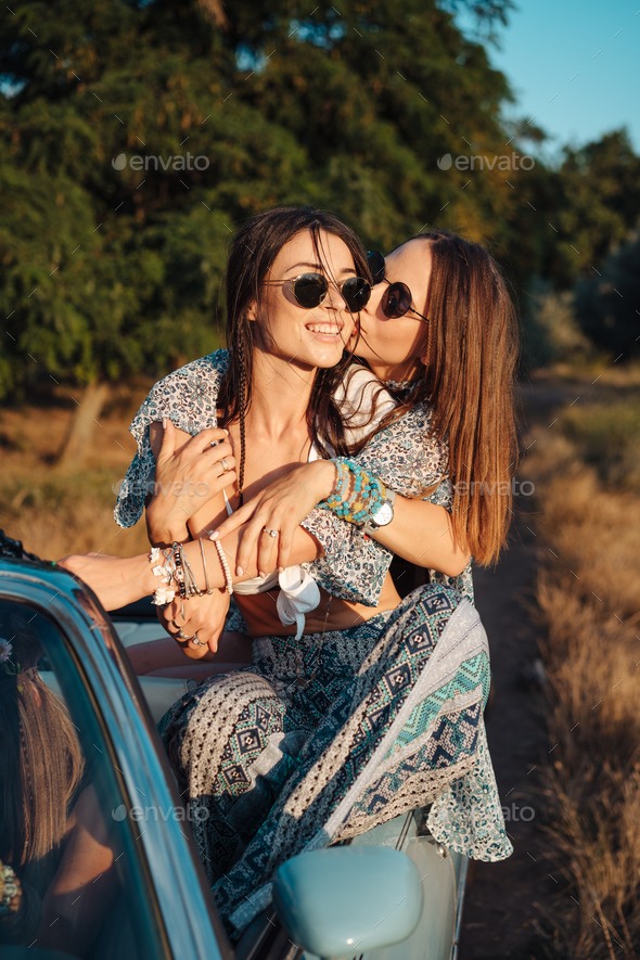 Two girls have fun in the countryside - Stock Photo - Images
