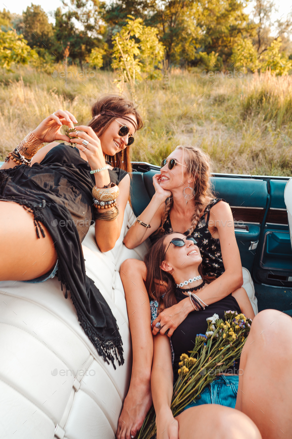 Girls lie in a gig and pose on camera - Stock Photo - Images