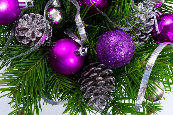 Christmas garland with silver glittercones and purple ornaments - Stock Photo - Images