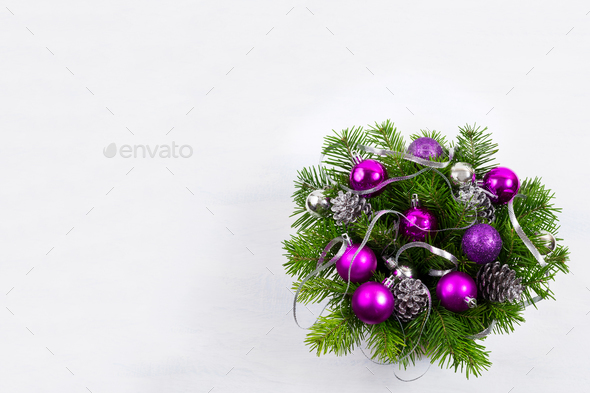 Christmas wreath with silver ribbon and purple baubles, copy spa - Stock Photo - Images
