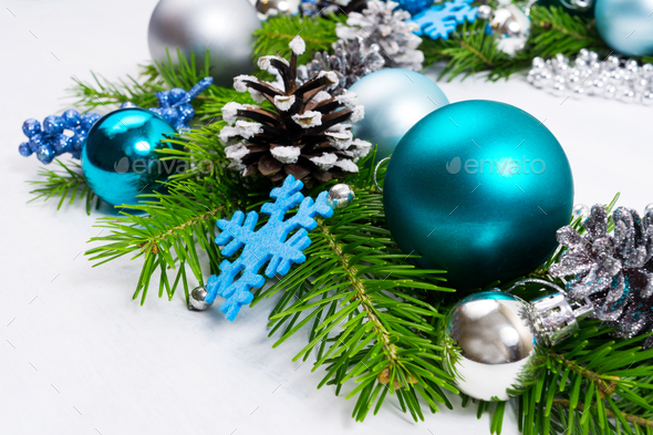 Christmas background with silver, blue and turquoise baubles - Stock Photo - Images