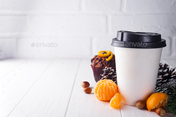 Paper cup of coffee surrounded by Christmas decorations - Stock Photo - Images