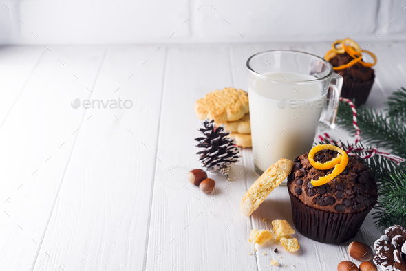Freshly baked homemade chocolate muffins with jug with milk - Stock Photo - Images