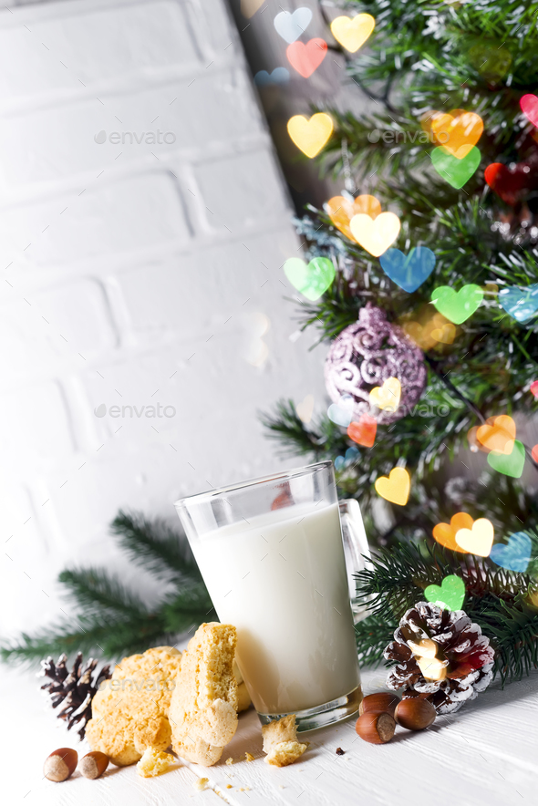 Cookie that is half eaten with milk - Stock Photo - Images