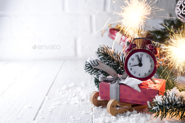 New Year's clock with burning Bengal fire - Stock Photo - Images