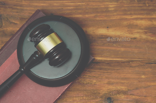 Gavel and law book on a wooden background - Stock Photo - Images