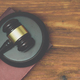 Gavel and law book on a wooden background - PhotoDune Item for Sale