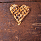One belgian heart shaped waffle with chocolate on wooden background. Flat lay. Copy space - PhotoDune Item for Sale