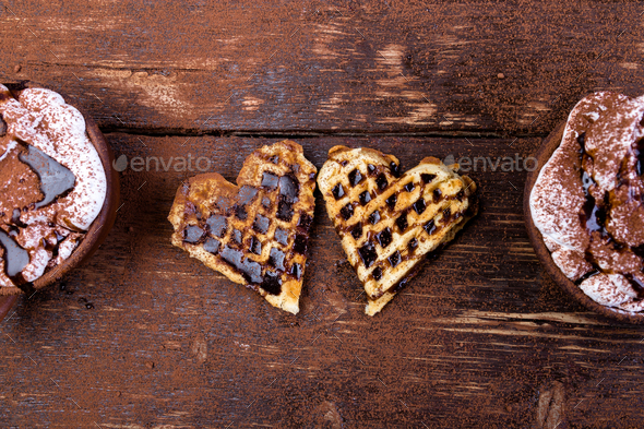 Belgian heart shaped waffle with hot chocolate with marshmallow on wooden background. - Stock Photo - Images