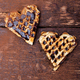 Two belgian heart shaped waffle with chocolate on wooden background. Flat lay. Copy space - PhotoDune Item for Sale