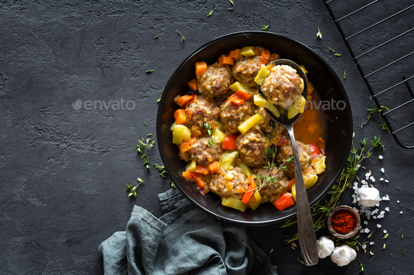 Meatballs in sauce with vegetables, top view - Stock Photo - Images