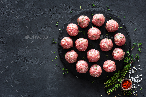 Raw meatballs on dark background, top view - Stock Photo - Images