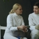 Two Young Fencers Man and Woman Watching Fencing Competition on Smartphone and Sharing Experience - VideoHive Item for Sale