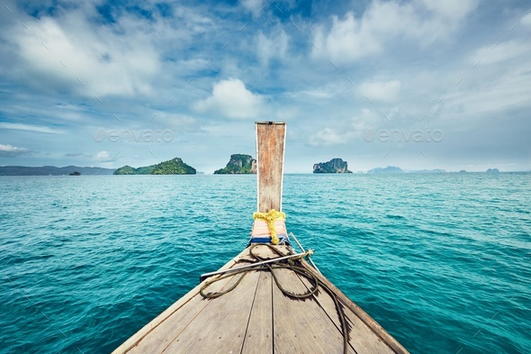 Trip by traditional long tail boat - Stock Photo - Images