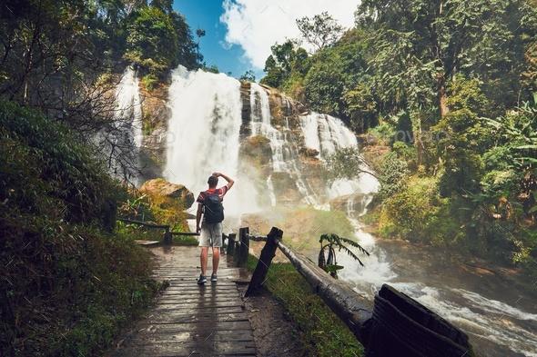 Traveler near waterfall - Stock Photo - Images