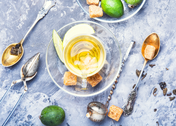 Tea with lime and feijoa - Stock Photo - Images