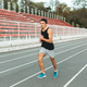 Young athletic man running on the stadium in the morning - PhotoDune Item for Sale