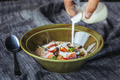 Granola. Granola with milk and berries on the table. - PhotoDune Item for Sale