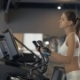 Sports Woman Training Cardio Exercise on Cross Trainer in Fitness Clube - VideoHive Item for Sale
