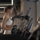 Sports Woman Using Screen on Treadmill for Settings Cardio Exercise in Gym Club - VideoHive Item for Sale
