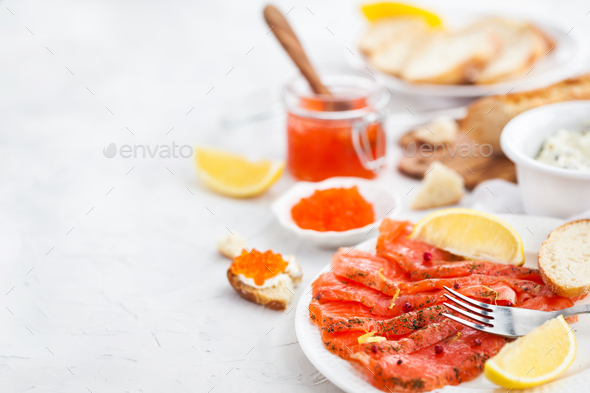 Delicious lunch with salted salmon, red caviar, fresh bread and - Stock Photo - Images