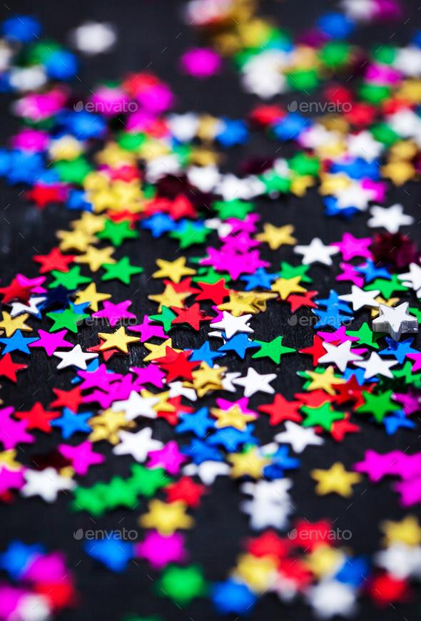 Multicolored holiday stars decoration background - Stock Photo - Images