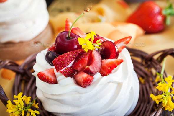 Delicious mini Pavlova meringue cake decorated with fresh berrie - Stock Photo - Images