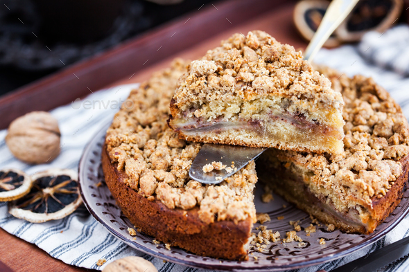 Piece of fresh homemade apple and cinnamon crumb coffee cake - Stock Photo - Images
