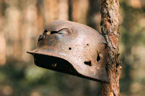 Damaged By Bullets And Shrapnel Metal Helmet Of German Infantry - Stock Photo - Images
