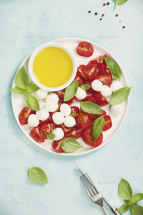 Caprese salad with basil and mozzarella balls - Stock Photo - Images