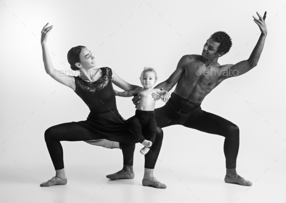 A happy family of ballet dancers on white studio background - Stock Photo - Images