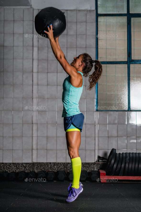 Woman athlete exercising with medicine ball - Stock Photo - Images