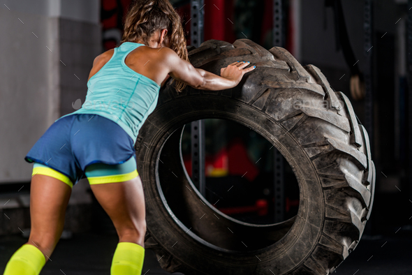 Woman athlete exercising with tire - Stock Photo - Images