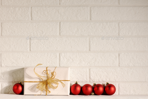 gift with red baubles - Stock Photo - Images