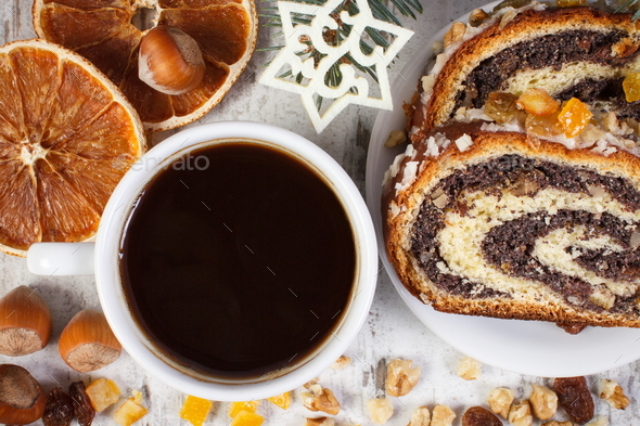 Poppy seeds cake, cup of black coffee and spruce branches, dessert for Christmas festive time - Stock Photo - Images