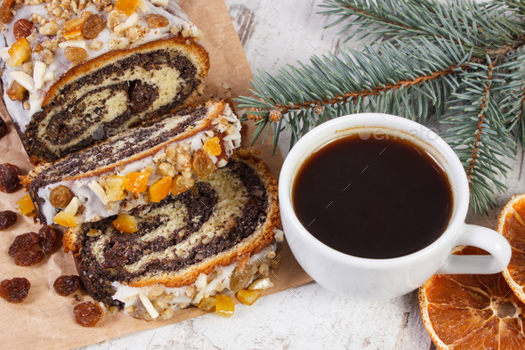 Poppy seeds cake, cup of black coffee and spruce branches, dessert for Christmas - Stock Photo - Images