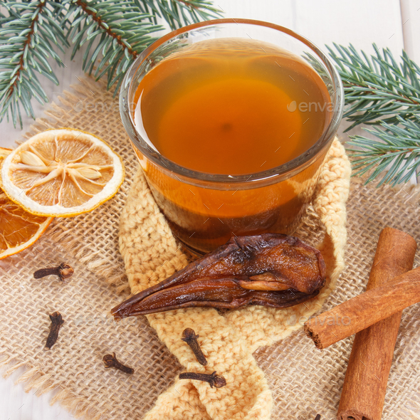 Spruce branches and cup of traditional compote of dried fruits for Christmas - Stock Photo - Images