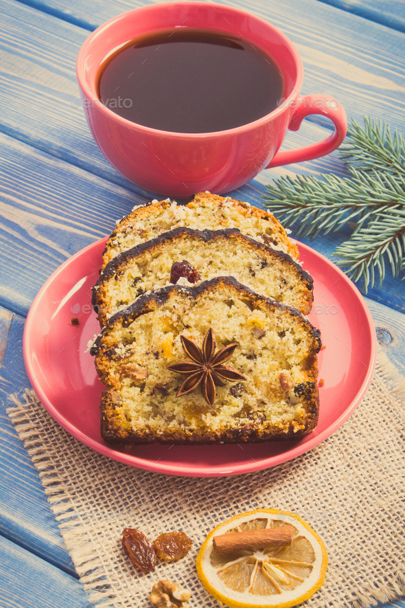 Vintage photo, Cup of coffee, fresh fruitcake for Christmas and spruce branches - Stock Photo - Images