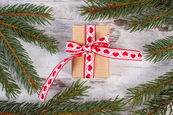 Wrapped gift with ribbonand spruce branches for Christmas or Valentines - Stock Photo - Images