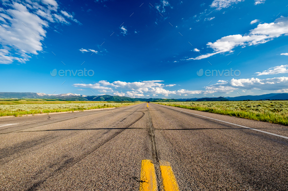 Empty open highway in Wyoming - Stock Photo - Images