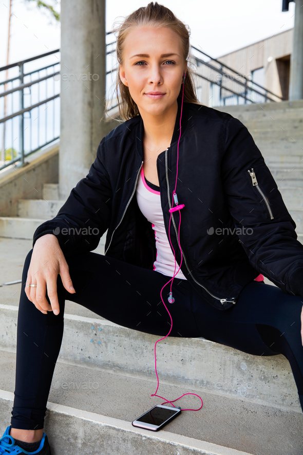 Woman In Sportswear Listening Music On Mobile Phone At Stairway - Stock Photo - Images