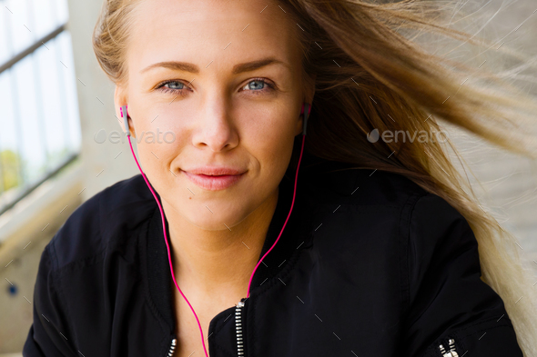 Close Portrait of Blonde Woman In Sportswear Listening To Music - Stock Photo - Images