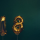 Hands holding golden 18 balloons, new year concept - PhotoDune Item for Sale